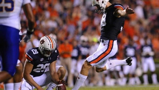 Auburn holder Tyler Stovall (29) was one of seven walk-ons who was awarded a scholarship for the 2017 season.