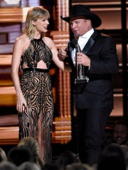 Taylor Swift returned to the CMAs to give Garth Brooks