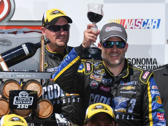 Tony Stewart (14) celebrates in victory lane during the Toyota Save Mart 350 at Sonoma Raceway.