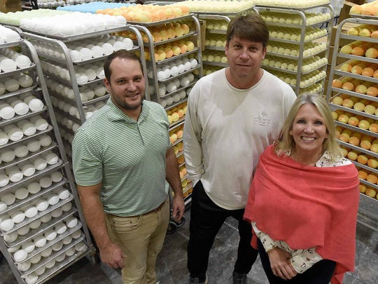 "Musee owners (from left) Vice President and CFO Adam Pierce, Managing Director Ian MacDonald and President and CEO Leisha Pickering pose near racks of finished bath balms at their production facility in Canton on Feb. 13. ""It was a small idea but really flourished,"" Pickering said of the business."