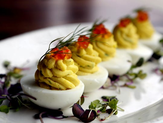 Deviled eggs with dill and salmon caviar at Freebird