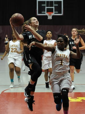 West Allis Hale guard Alyssa Cruz (left) breaks away for a layup as West Allis Central''s Antionette Powell attempts to block her shot during the Huskies' 66-39 triumph on Dec. 2. Cruz finished with 14 points for the Huskies.