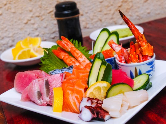 Pieces of squid, octopus, shrimp, clams, crab, salmon roe, vegetables and several kinds of fish are served in the combination sashimi platter at the Rotary Sushi & BBQ restaurant in Tumon on July 6.