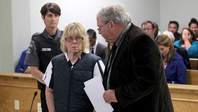 Joyce Mitchell stands with her lawyer, Stephen Johnston, during a hearing  in June.