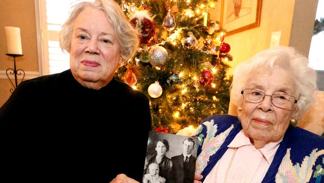 Ann Coleman, left holds a photo next to ther mom Frances Virginia Snell Austin. The photo shows  Frances Virginia Snell Austin as a baby with her parents father Francis Marion Snell, and mother Mattie Lou Jernigan Snell, on Wednesday, Dec. 14, 2016. Ann Coleman the daughter of Frances Virginia Snell is looking for the lost wedding band that once belonged to Mattie Lou Jernigan Snell.