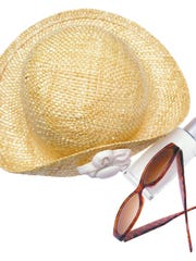 Hat, sunglasses and bottle of suntan lotion