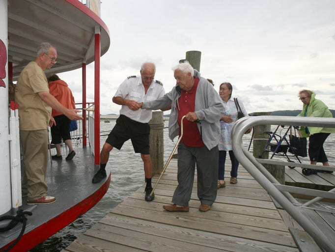 "Larry D. Singer, left, the President of the Board of Trustees, along with boat crew members, help visitors on the River Rose paddle boat as they prepare for the Historical Society of Rockland County's tour called, ""The Tappan Zee Bridge Experience: Past, Present and Future"" Aug. 12, 2014.  About 150 people signed up for the history tour that left from the Haverstraw Boat Club in West Haverstraw."