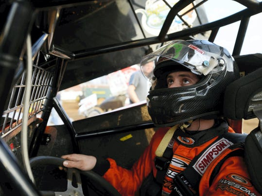 Austin Hogue checks the movement of his top wing after completing warm-up laps at Williams Grove Speedway in Mechanicsburg on April 1. Hogue was named Rookie of the Year last season Williams Grove, Lincoln Speedway and the North American Sprint Car Poll.