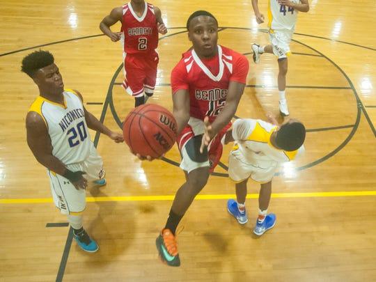 James M Bennett guard Malik Shockley (12) goes up for