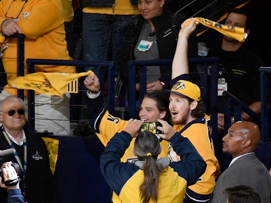 Injured Predators Kevin Fiala and Ryan Johansen (92) get the crowd going before game 6 of the Western Conference finals at Bridgestone Arena Monday, May 22, 2017 in Nashville, Tenn.