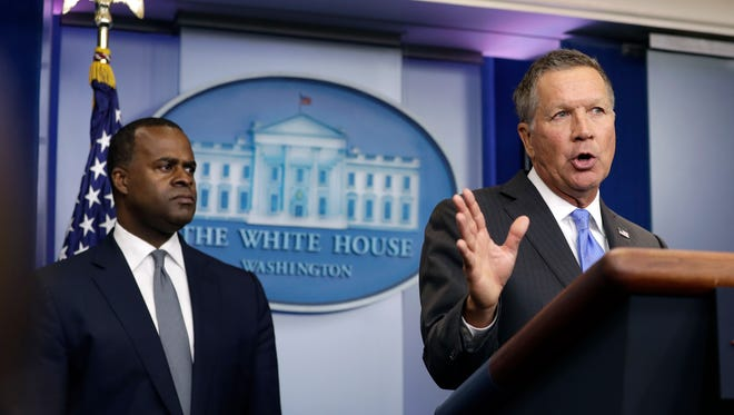 Atlanta Mayor Kasim Reed listens at left as Ohio Gov. John Kasich speaks during the daily news briefing at the White House in Washington, Friday, Sept. 16, 2016. Kasich and Reed discussed the presidential campaign and TPP, following a meeting with president in the Oval Office. (AP Photo/Carolyn Kaster)