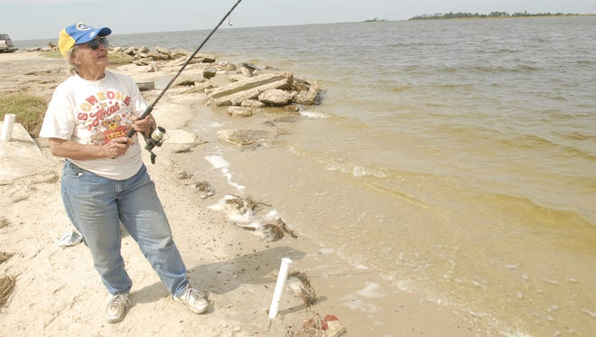 Anna Brown fishes from Guard Shore in this 2008 photograph.