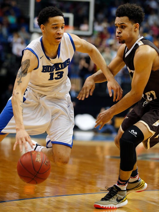 In this photo taken March 10, 2016, Hopkins High School's Amir Coffey, left, drives past Apple Valley's Gary Trent Jr. during a class 4A quarterfinal boys high school basketball game in Minneapolis. Coffey was selected as the Minnesota Associated Press Player of the Year for boys basketball, Tuesday, March 15, 2016. (Richard Tsong-Taatarii/Star Tribune via AP)  MANDATORY CREDIT; ST. PAUL PIONEER PRESS OUT; MAGS OUT; TWIN CITIES LOCAL TELEVISION OUT