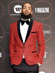 Nipsey Hussle, shown here, died in a shooting March 31. Now Kerry Lathan, a Los Angeles man wounded in the same attack, has been released from custody.