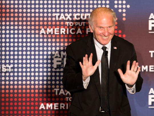 U.S. Rep. Steve Chabot, R-Westwood, waves  during the America First Tax Cuts to Put America First event at The Westin in downtown Cincinnati, Ohio, on Tuesday, Aug. 14, 2018.