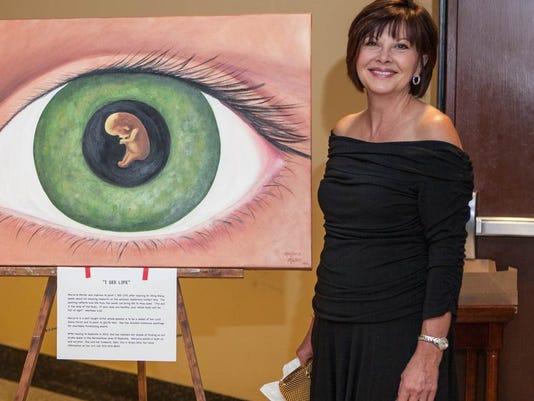 Ms Marjorie Mullen and her fetus in eyeball signature painting for EyeBall 2.jpg