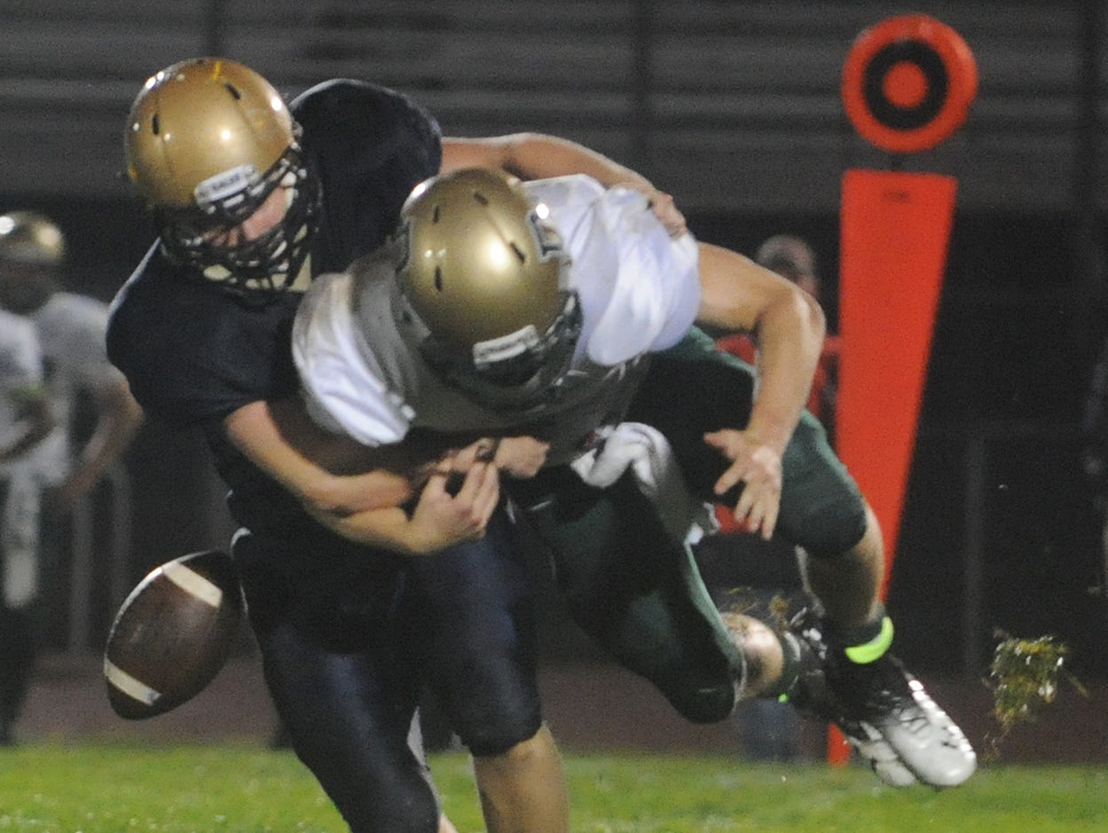 Lancaster's Ryan Roseberry knocks the ball loose from a Dublin Jerome player Friday, Sept. 4, 2015, at Fulton Field. The Gales defeated the Celtics 33-0.
