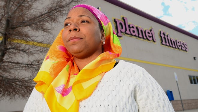 Tarainia McDaniel is shown in front of Planet Fitness in Albuquerque, N.M.