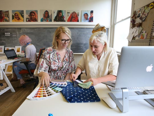 Maggie Clines, left, and her sister Colleen Clines select fabric colors at the Anchal textile company.