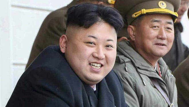 North Korean leader Kim Jong Un, left, attends a shooting practice at a military academy in Pyongyang, North Korea.