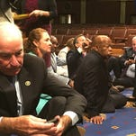 In this photo provided by Rep. John Yarmuth, D-Ky., Democratic members of Congress, including Rep. John Lewis, D-Ga., center, and Rep. Joe Courtney, D-Conn., left, participate in sit-in protest on the floor of the House on June 22, 2016.