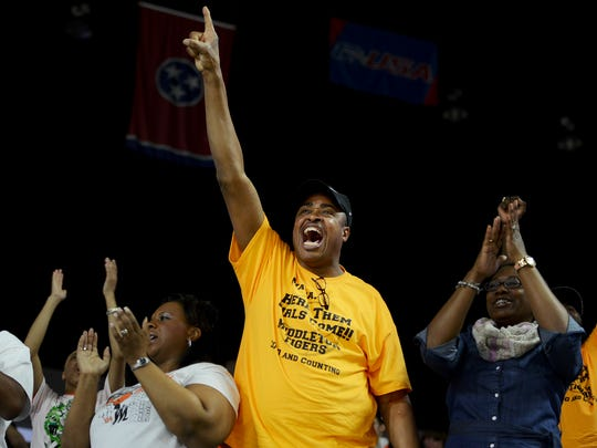 David Perry, father of Middleton's Chelsey Perry celebrates Middleton's win during their 2015 TSSAA Class A Championship game, Sunday, against Clarkrange High School. C. Perry received tournament MVP. Middleton defeated Clarkrange, 62-50 to become the 2015 TSSAA Girls' Class A Champions and have a 35-0 undefeated season.