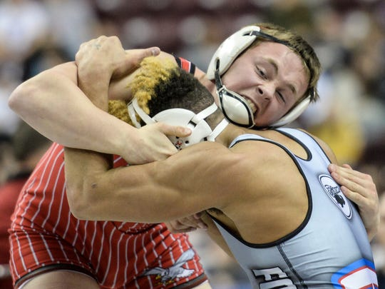 Bermudian Springs' Noah Fleshman locks up with Ft. LeBoeuf's Julian Gorring during the second day of the PIAA Class AA wrestling championships.