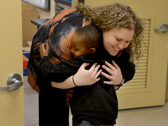 Whitehall Pre-K teacher Anna Church hugs her student Trebian Pickett during a January  open house at Nova School, Jan. 24, 2017. Whitehall will temporarily be housed at Nova due to hail damage.