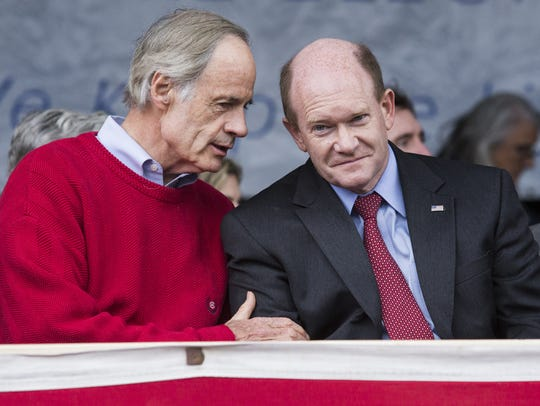 Sen. Tom Carper (left) and Sen. Chris Coons have sponsored a bill that would exclude farmers from reporting onsite data on air pollution emissions related to livestock, such as chickens.