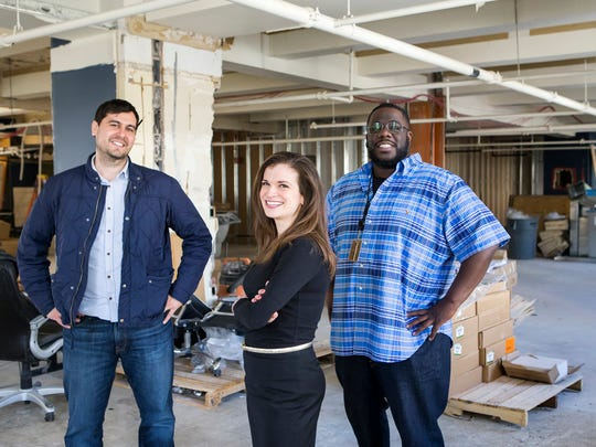 Robert Herrera (left), president and founder of the Mill, stands with Zip Code's head of school Melanie Augustin and director of education and Tariq Hook in April at the unfinished office space Zip Code took over at the Mill in Wilmington.