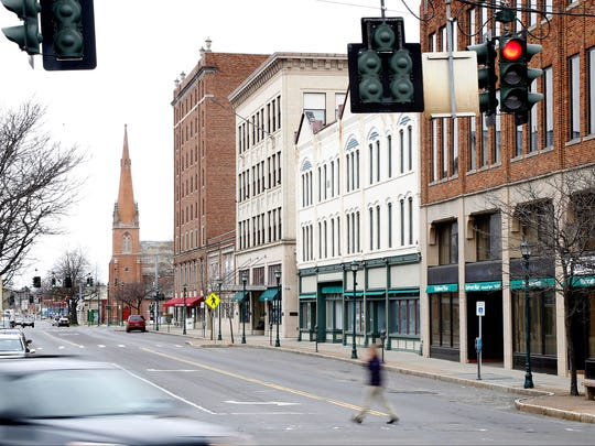 Officials hope Elmira's Downtown Revitalization Initiative plan, which includes grant funding for property owners to renovate upper-story housing, will attract residents to the city's core.