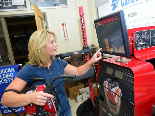 Elisa Ramsey, welding instructor, demonstrates the