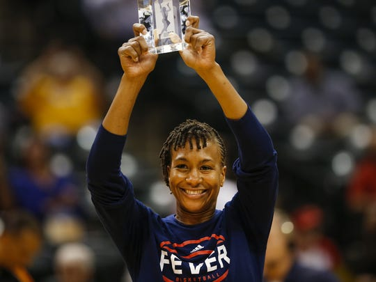 Indiana Fever forward Tamika Catchings (24) is awarded a WNBA sportsmanship award prior to facing off against the Phoenix Mercury at Bankers Life Fieldhouse on Sept. 21, 2016.
