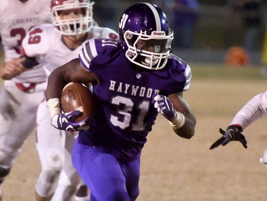 Haywood's Decourtney Reed runs the ball toward the