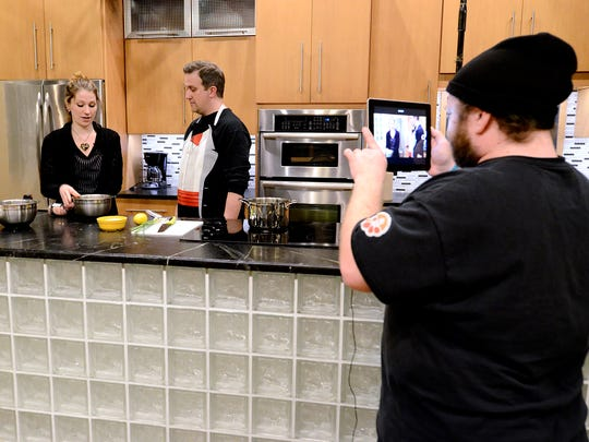 John Beck, right, films Kelly Sanders, left of York, and Tim Kaye at Central Market's Performance Kitchen for Kaye's YouTube series, Vegan Quest , Wednesday, Dec. 6, 2017. John A. Pavoncello photo