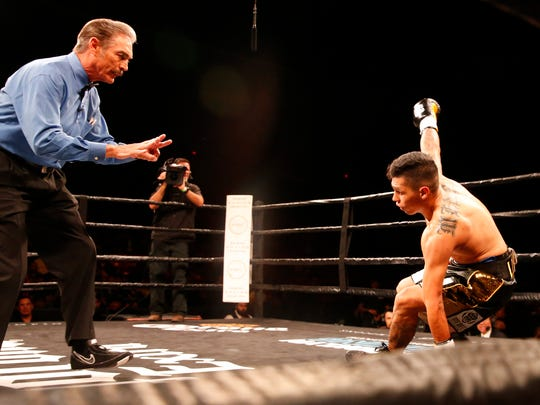Referee Rocky Burke counts out Jorge Lara just 33 seconds into the first round as he tries to get back to his feet after being knocked out by Claudio Marrero of their scheduled 10 round fight at the Don Haskins Center.