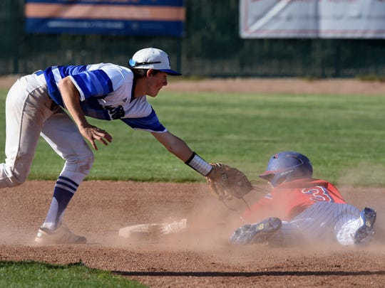 McQueen's Austin Parry reaches to tag Reno's Garret Damico as he slides into second base. Damico was called safe on the play Thursday.
