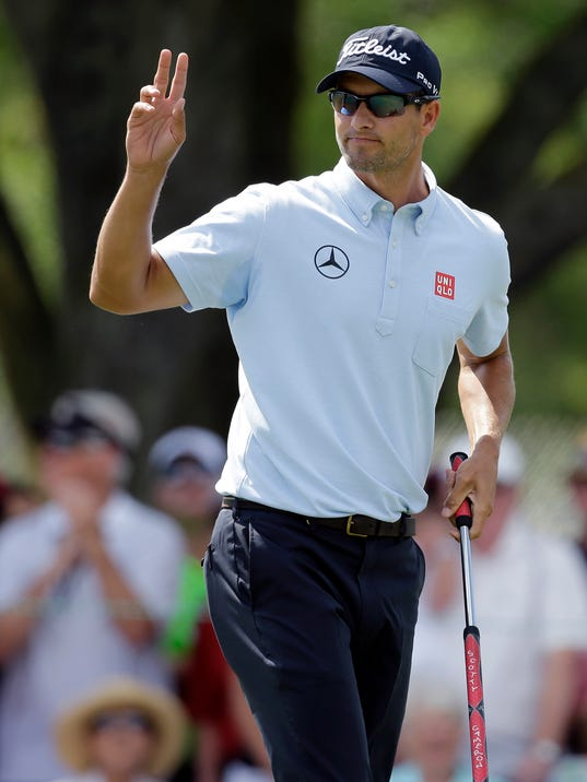 Adam Scott, of Australia, waves after making birdie on the ninth hole during the second round of the Arnold Palmer Invitational golf tournament at Bay Hill Friday, March 21, 2014, in Orlando, Fla. (AP Photo/Chris O'Meara)