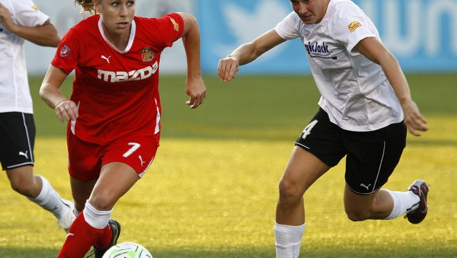 McCall Zerboni, left, shown dribbling against Sarah Huffman in a 2011 match, was reacquired by the Flash on Tuesday via a trade with Boston.