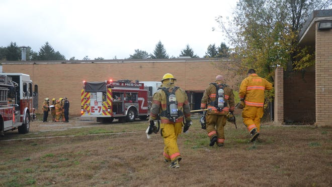 Firefighters were called to the vacant Crosby School in Emmett Township to extinguish a small fire on Friday.