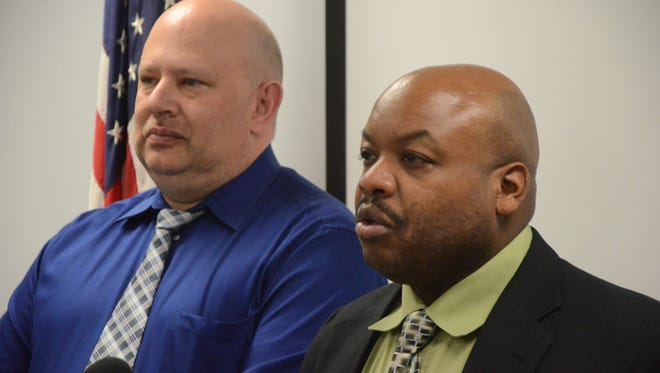 Detective Scott Silverman, left, and Detective Sgt. Troy Gilleylen discuss the Babick case.