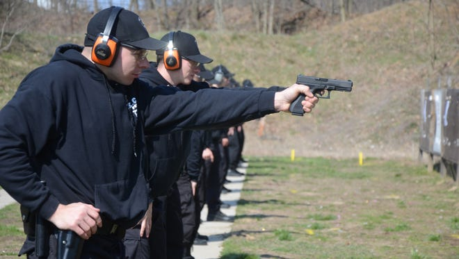 Students from the Kellogg Community College law enforcement class participate in firearms training.