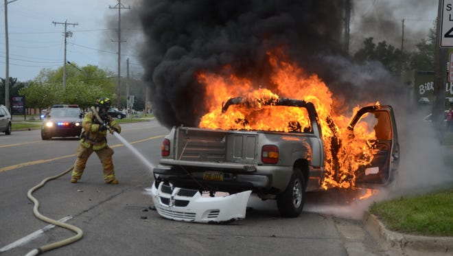 Battle Creek firefighters attack the vehicle fire.