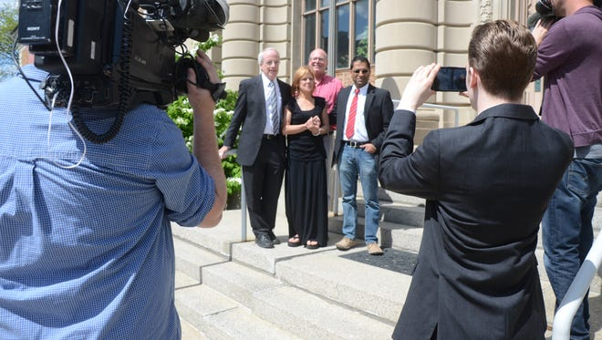 Lorinda Swain posed for pictures Wednesday after meeting with reporters