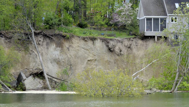 A home at 292 Plattsburg Avenue was damaged Sunday after the embankment that separated the home from the Winooski River slipped into the water.