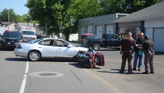 A woman suffered a head injury in this car-motorcycle collision on Sunday in Springfield.