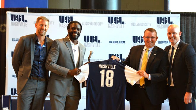 From left, DMD Soccer investors Christopher Redhage, Marcus Whitney, David Dill and USL President Jake Edwards during an announcement in July of the team's new name and logo. The group later changed its name to Nashville SC.