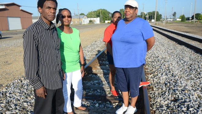 Trent Buckner's uncle, Bobby Holley, his mother, Delight Ansley and sisters, Sheena Buckner-Church, left, and Keena Buckner-Wharton at the site where the boy was found dead.