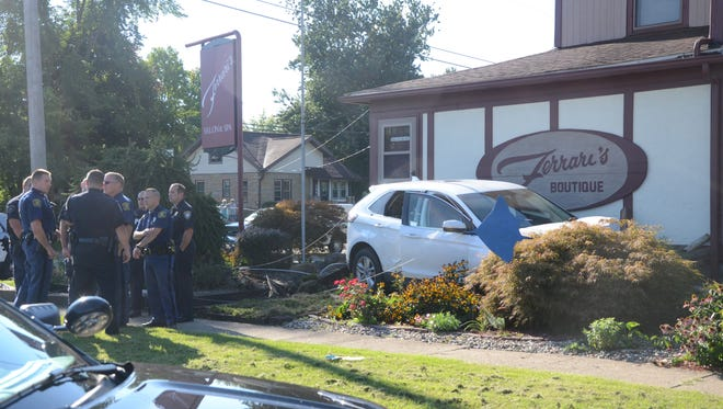 A police pursuit ended Friday after the suspects crashed into Ferrari's Boutique on Main Street in Emmett Township.