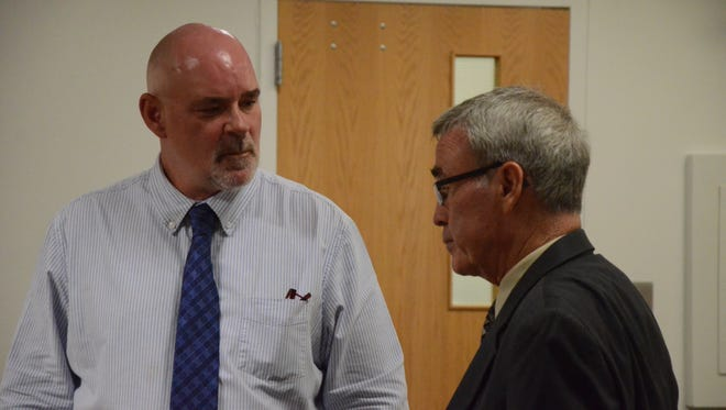 David Hursley, left, with attorney J. Thomas Schaeffer.